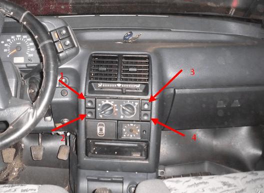 Панель приборов ВАЗ 2110 – описание кнопок рядом с печкой